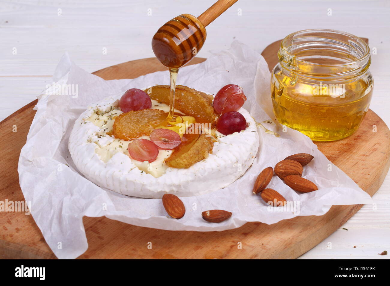 Camembert with fruit, honey and pear - Stock Image