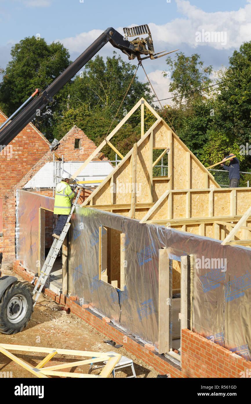 Buckingham uk october 13 2016 a builder at work on a building