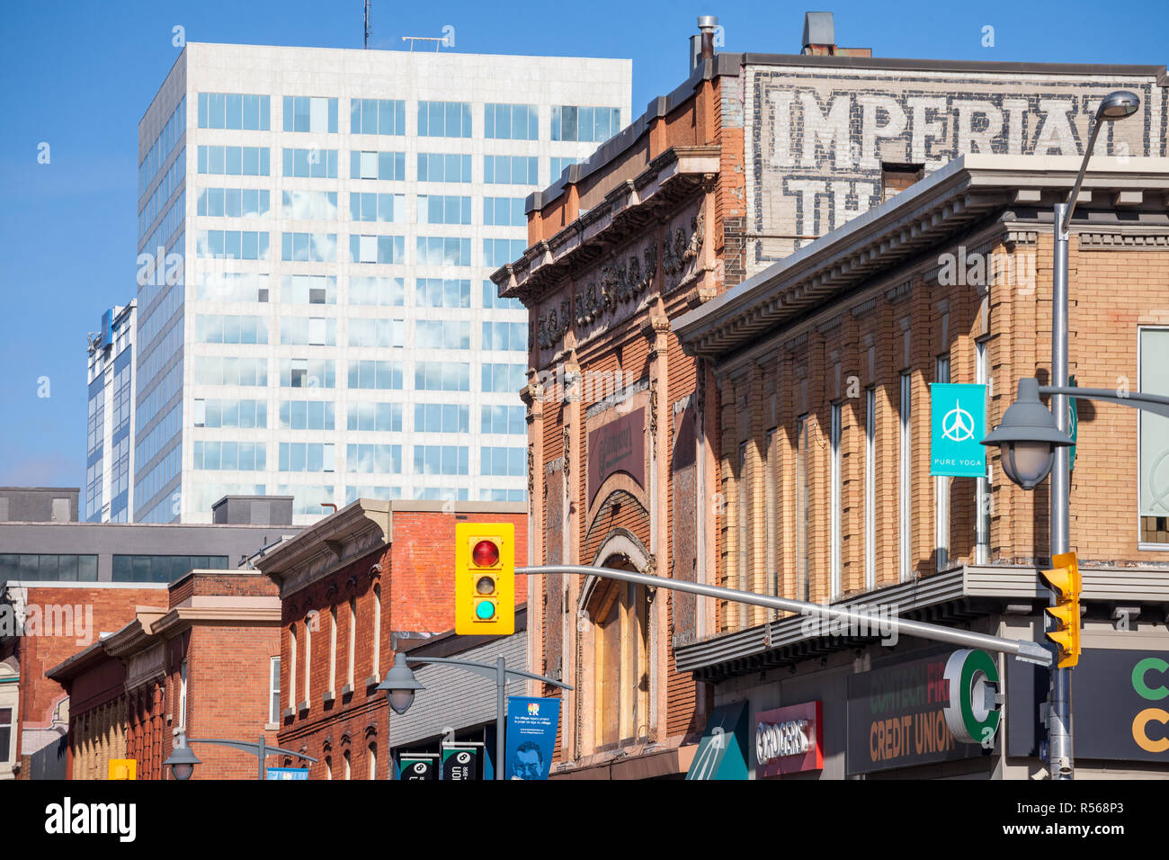 OTTAWA, CANADA - NOVEMBER 11, 2018: Old brick building facing a modern office tower on Bank Street, in Ottawa, Ontario,  on Bank Street, in Centretown - Stock Image