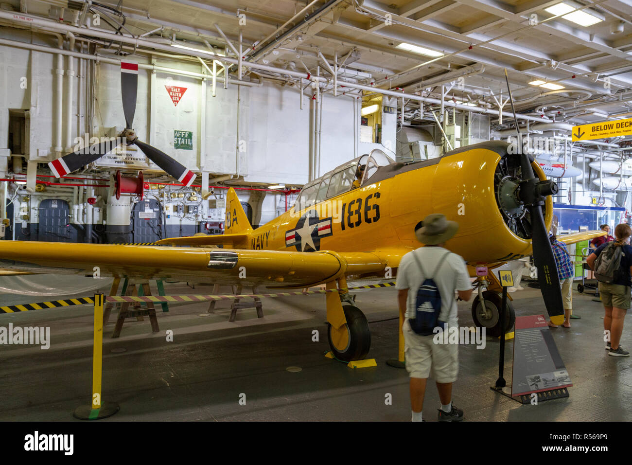 A SNJ pilot trainer aircraft by North American Aviation below decks on the USS Midway, San Diego, California, United States. - Stock Image