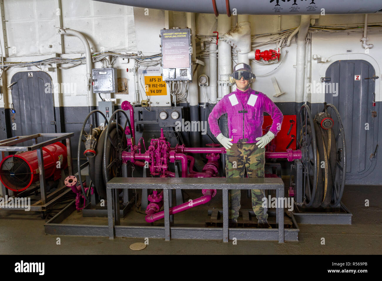 An aircraft refueling/defueling station below decks on the USS Midway, San Diego, California, United States. - Stock Image