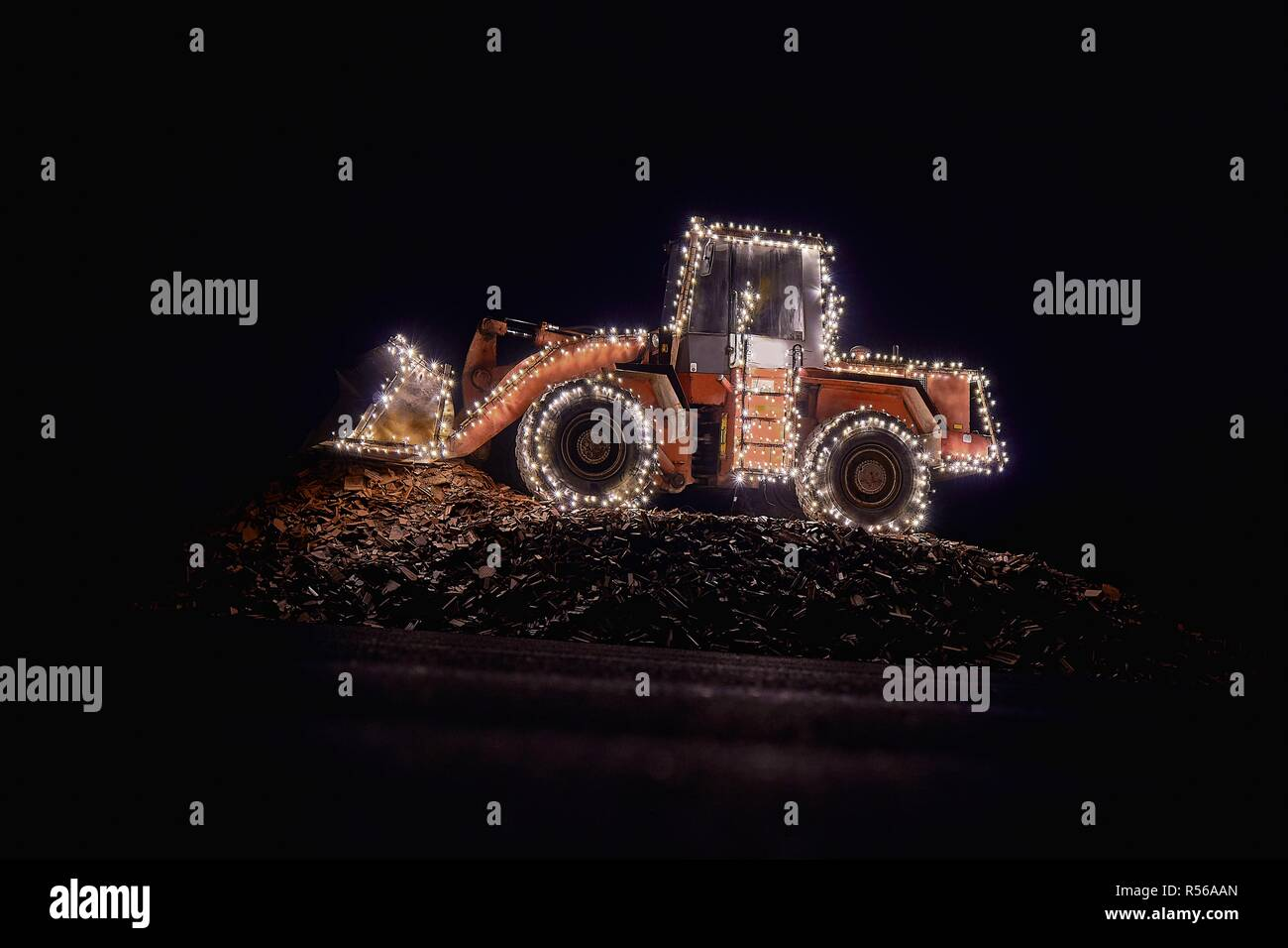 Blurred wheel loader decorated with lights Stock Photo