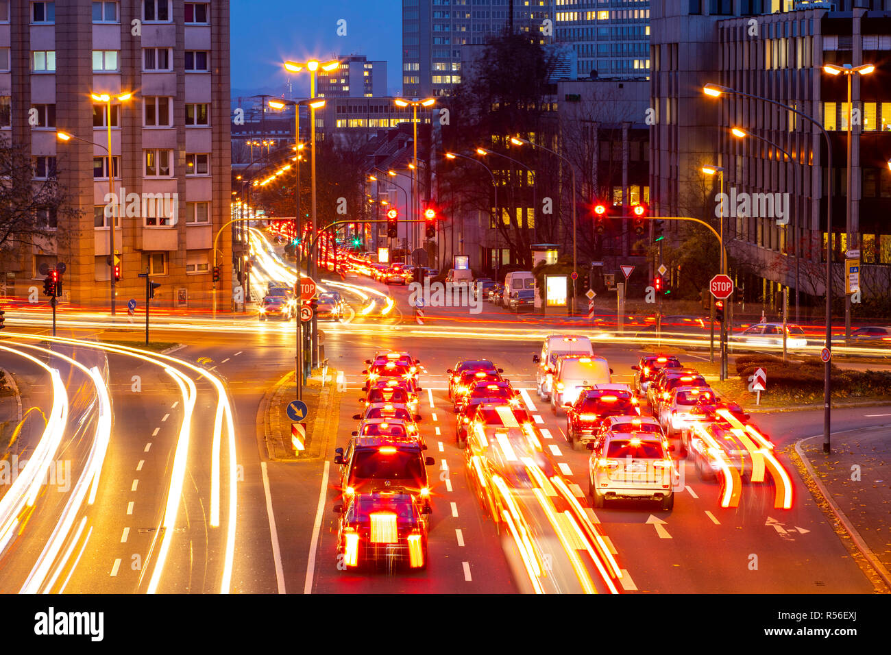 Evening city traffic in Essen, Germany, large intersection, the Bismarckstrasse, B224, Friedrichstrasse and Hohenzollernstrasse, this area would also  - Stock Image
