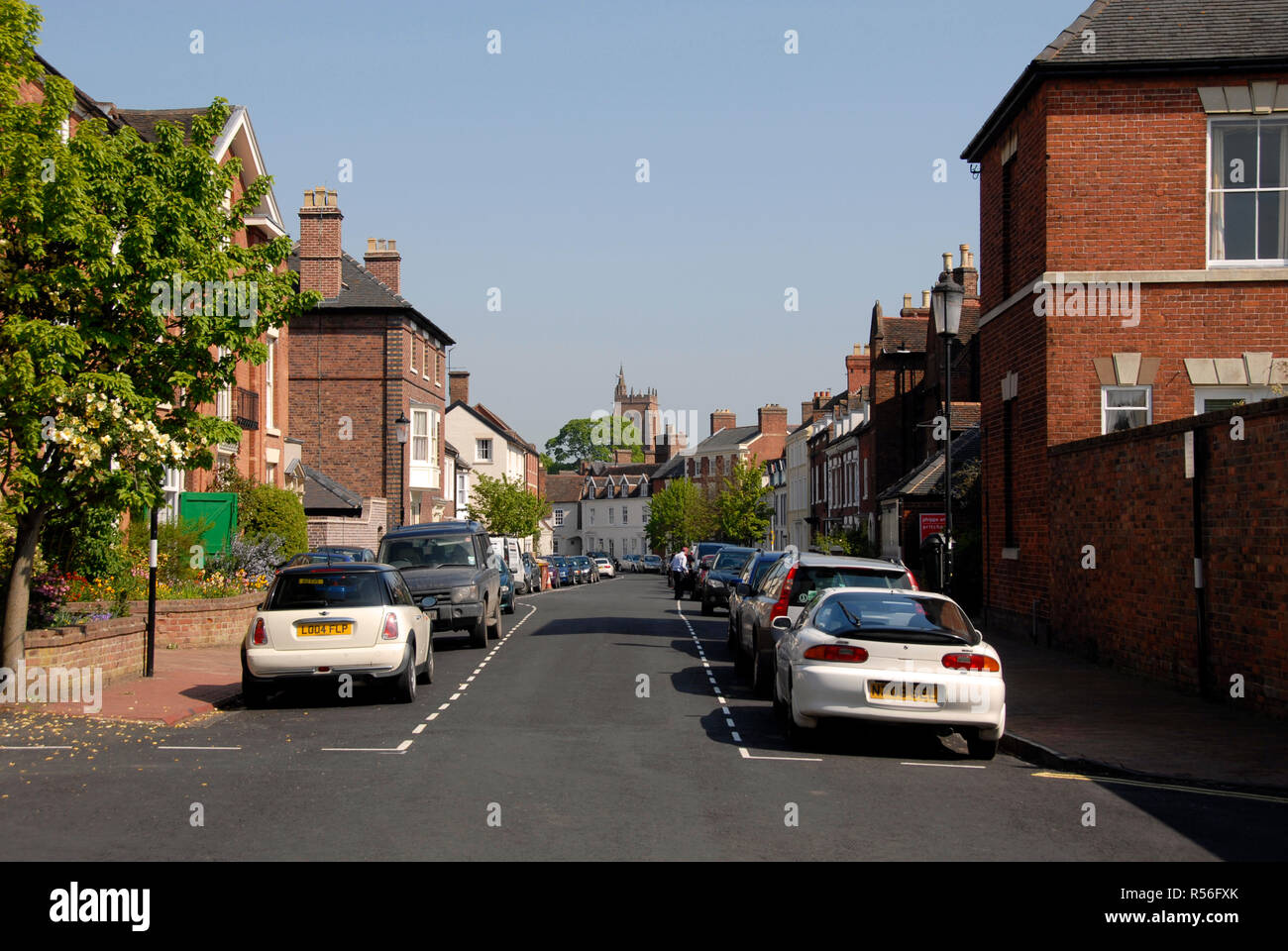 Quiet street in Bridgnorth, Shropshire, England, with vehicles parked both sides. - Stock Image