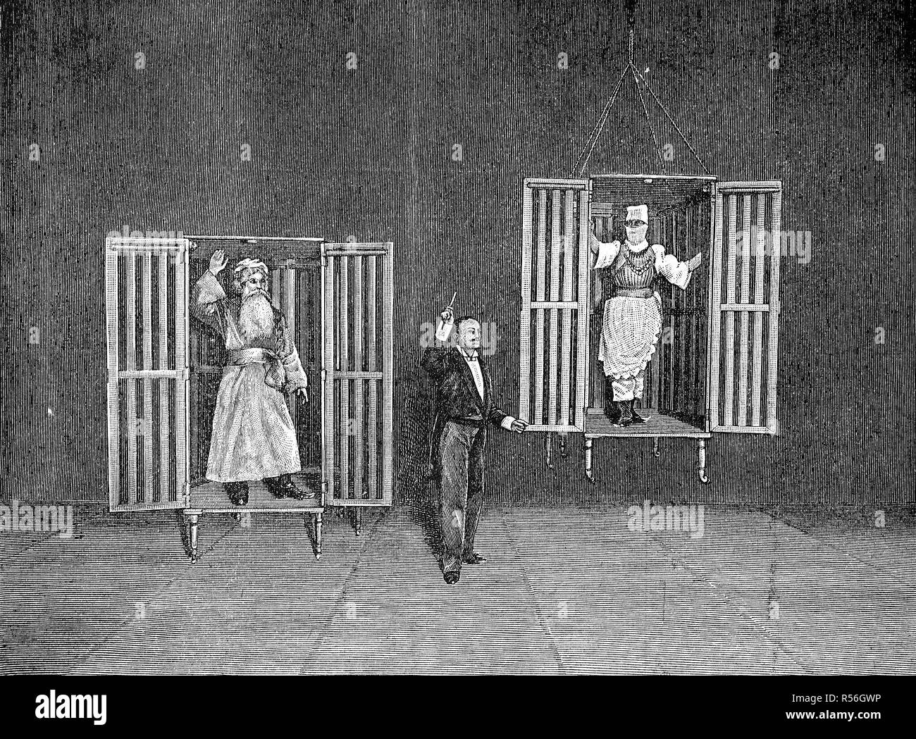 The illusionist Thorn demonstrates the appearance and disappearance of persons in cages, 1880, woodcut, England - Stock Image