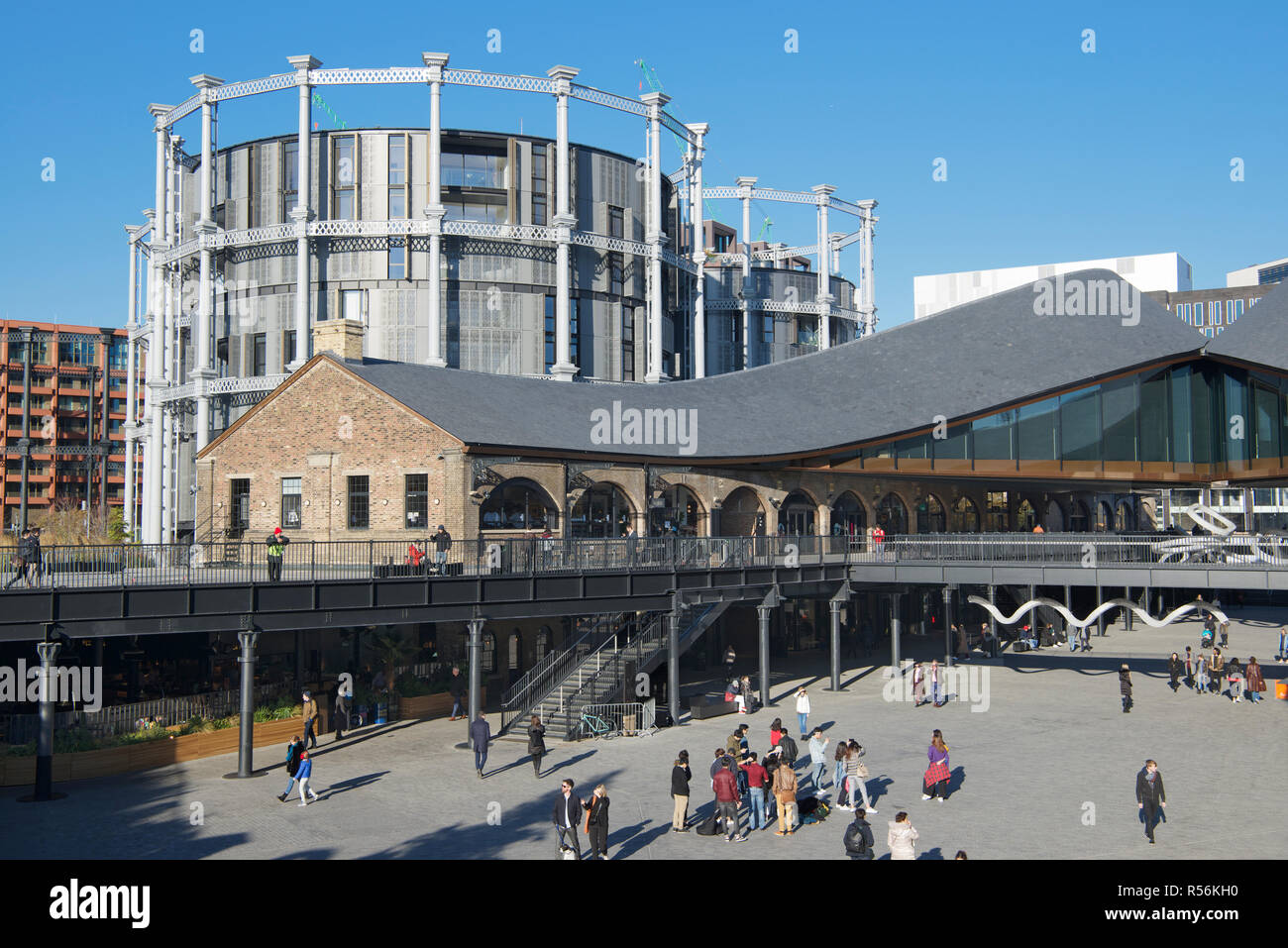 Coal Drops Yard modern development with converted luxury apartments from Victorian gas holders behind Kings Cross London England - Stock Image