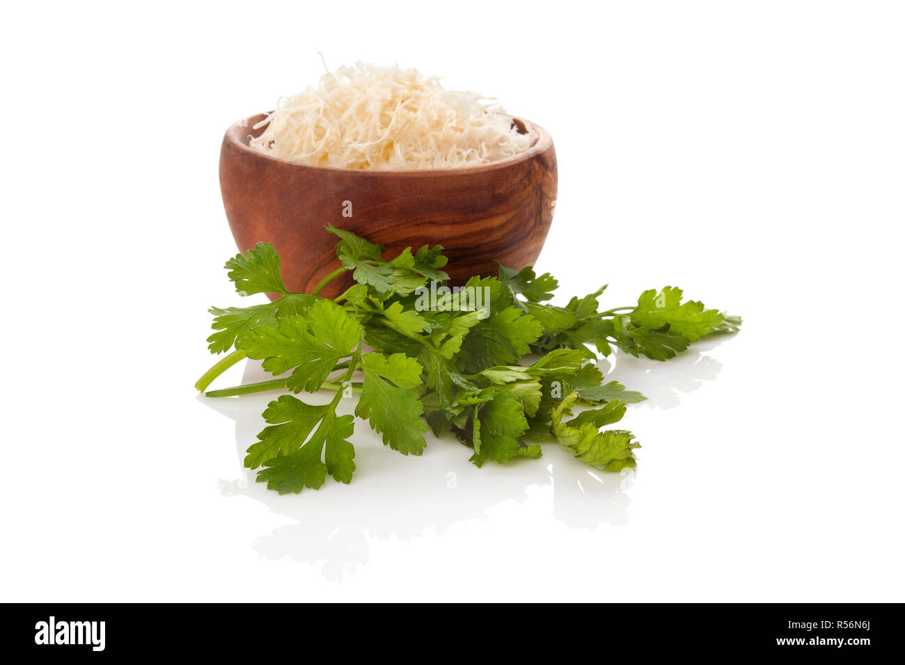 Grated horseradish with parsley. - Stock Image