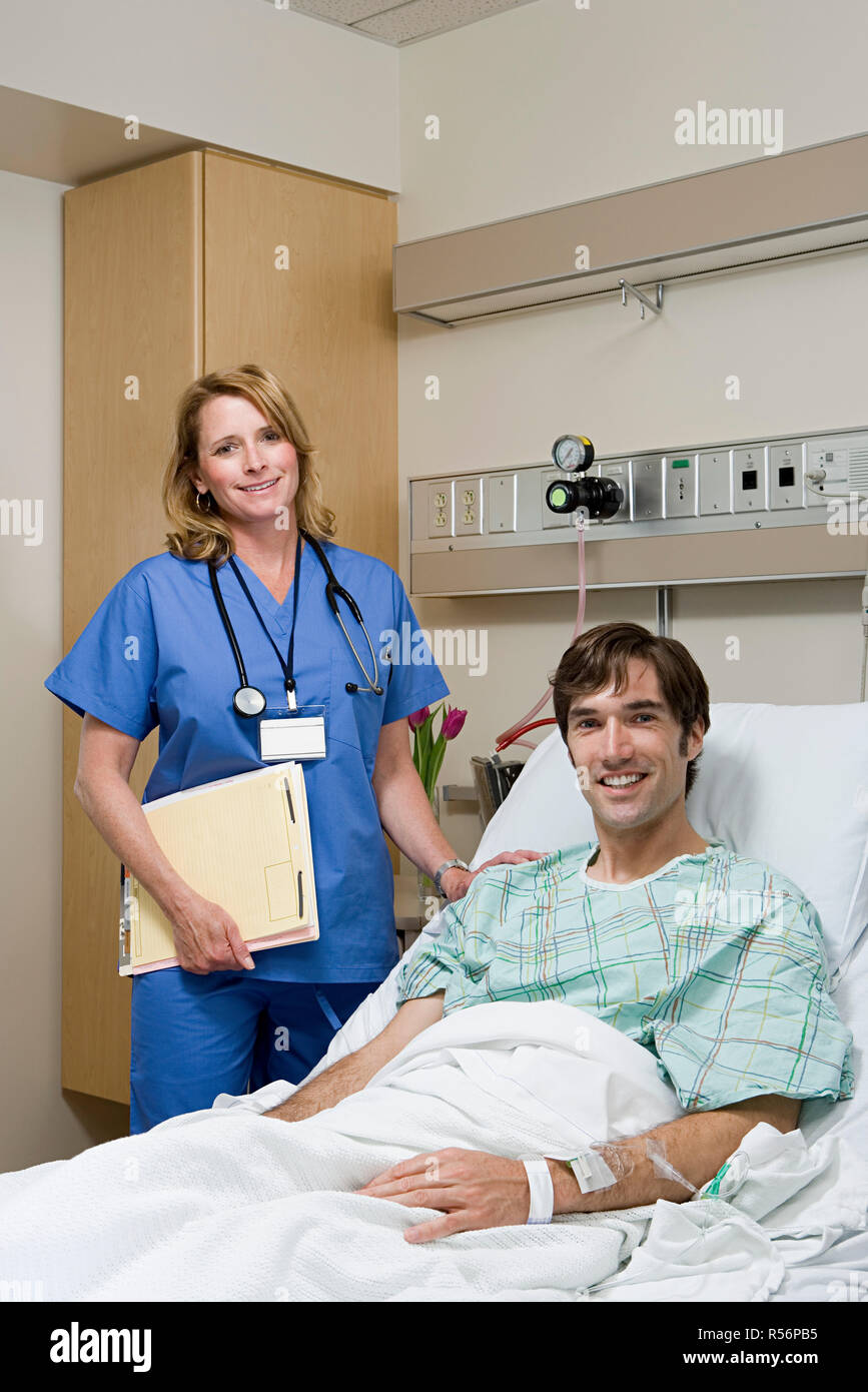Doctor and patient in hospital - Stock Image