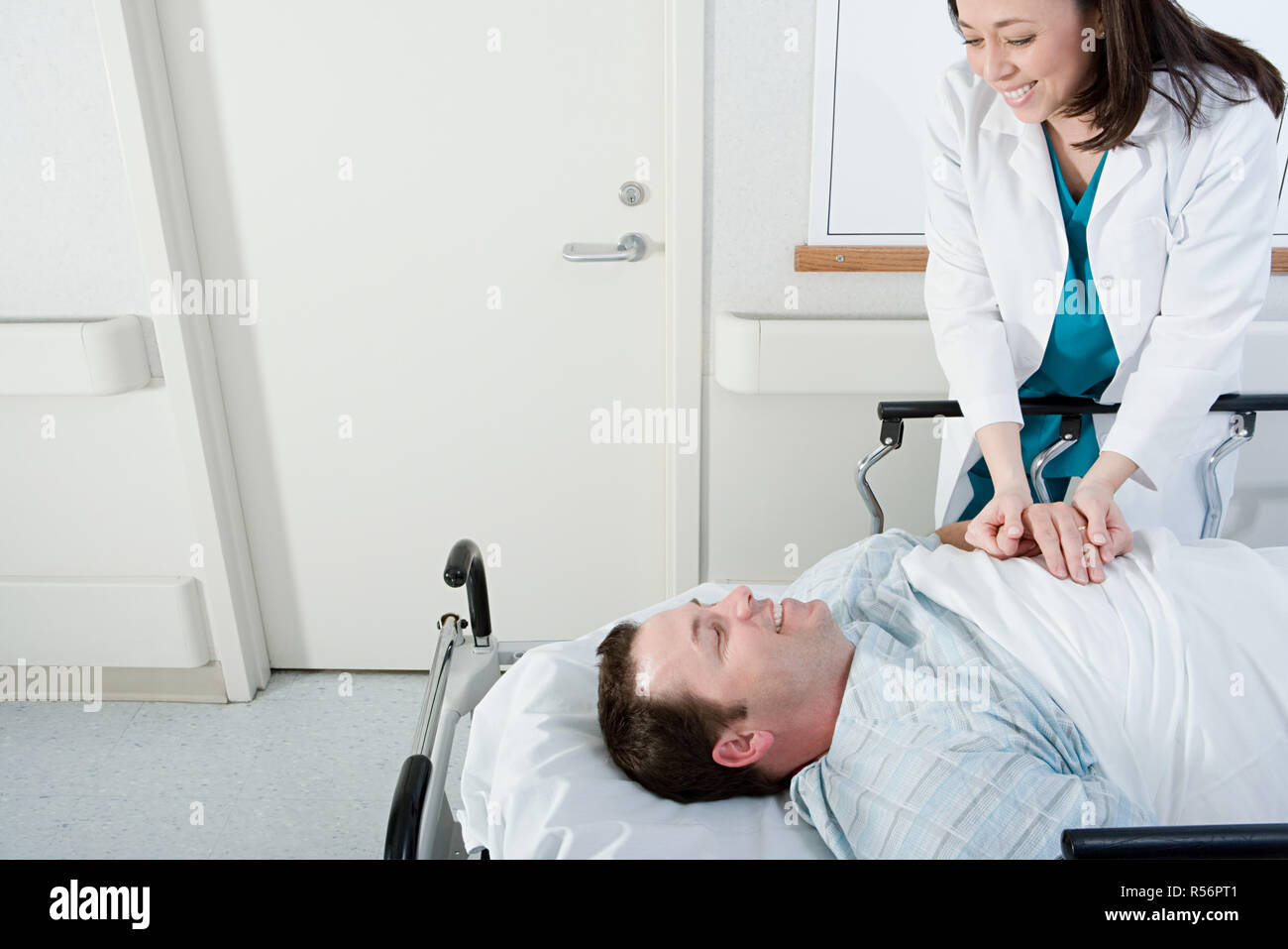 Doctor and patient in corridor - Stock Image