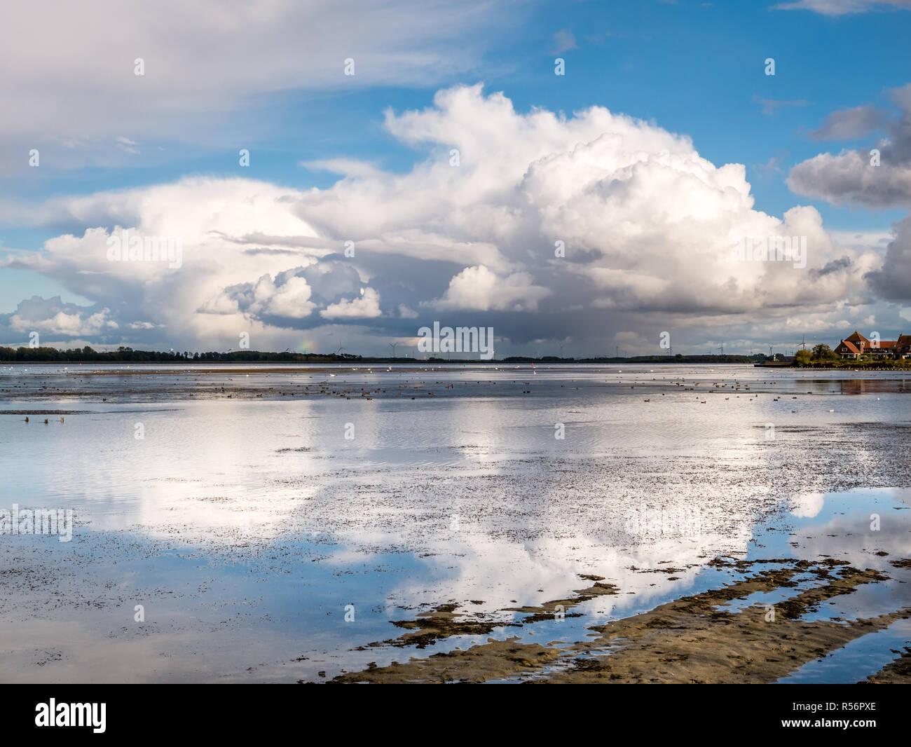 Rain clouds, cumulonimbus, over Gooimeer Lake near Huizen, Netherlands - Stock Image