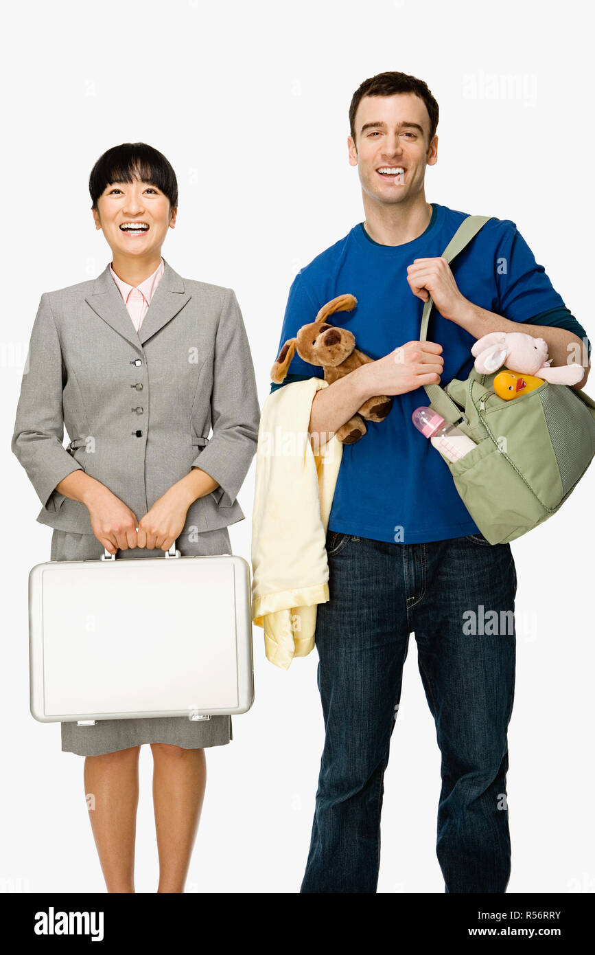 Businesswoman and husband - Stock Image
