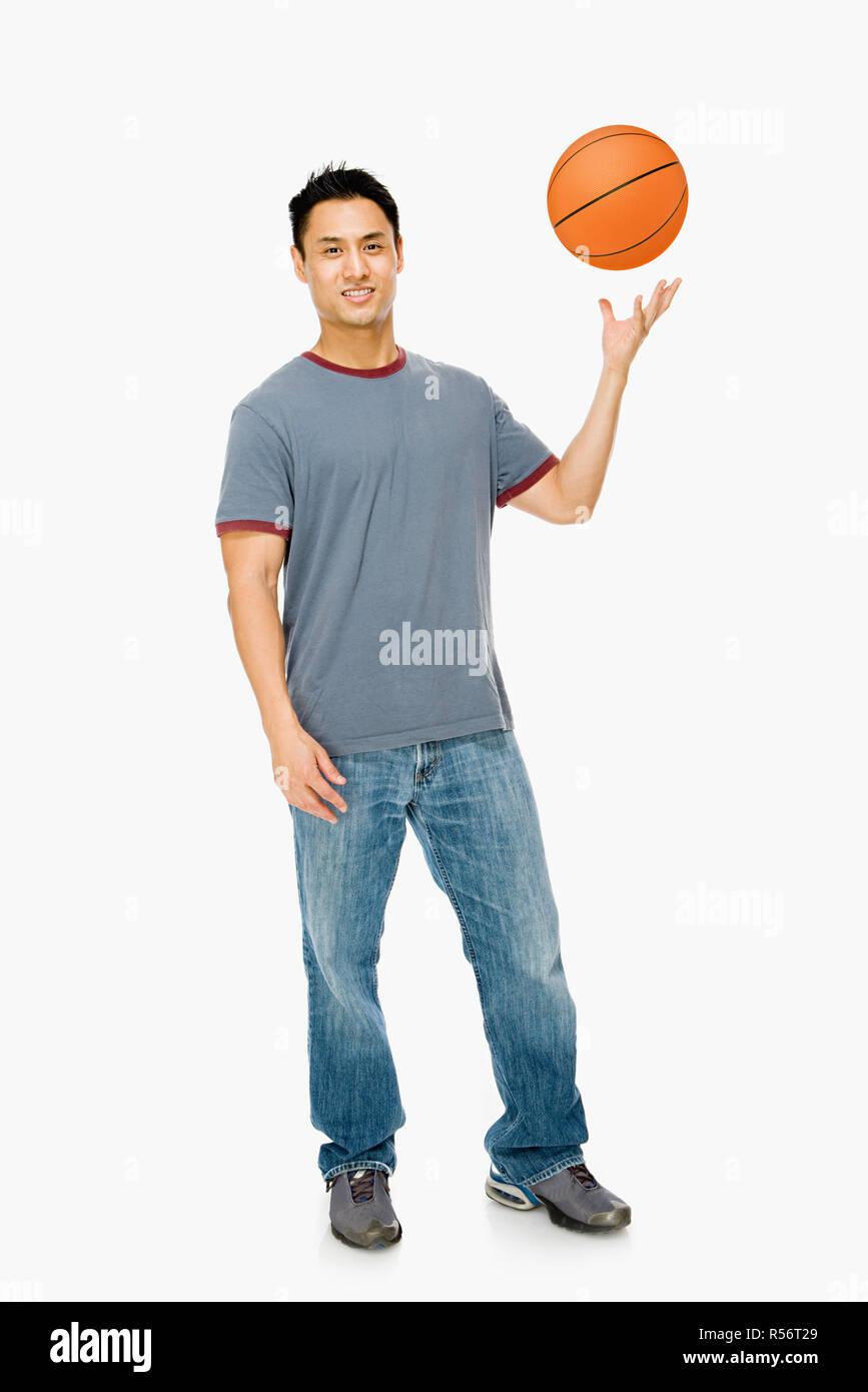 Man with basketball Stock Photo