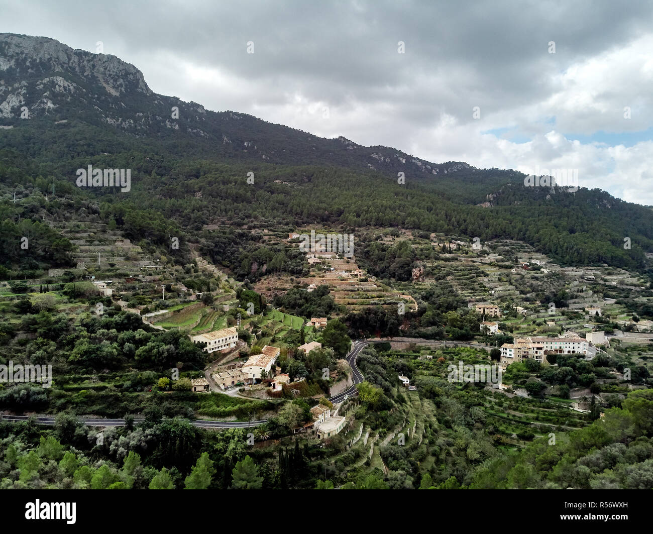 Aerial drone view of small hillside Banyalbufar town on west coast of Mallorca. Surrounded by Tramuntana mountain range Spain - Stock Image