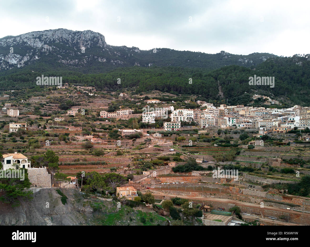 Aerial drone view of small hillside Banyalbufar town on west coast of Mallorca. Surrounded by Tramuntana mountain range. Spain - Stock Image