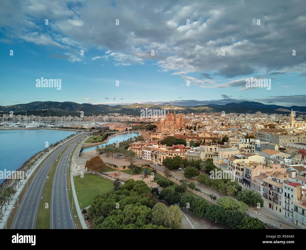 Aerial drone view Majorca cityscape, road along the coast of Mediterranean sea and famous Cathedral of Palma de Mallorca or Le Seu. Spain - Stock Image