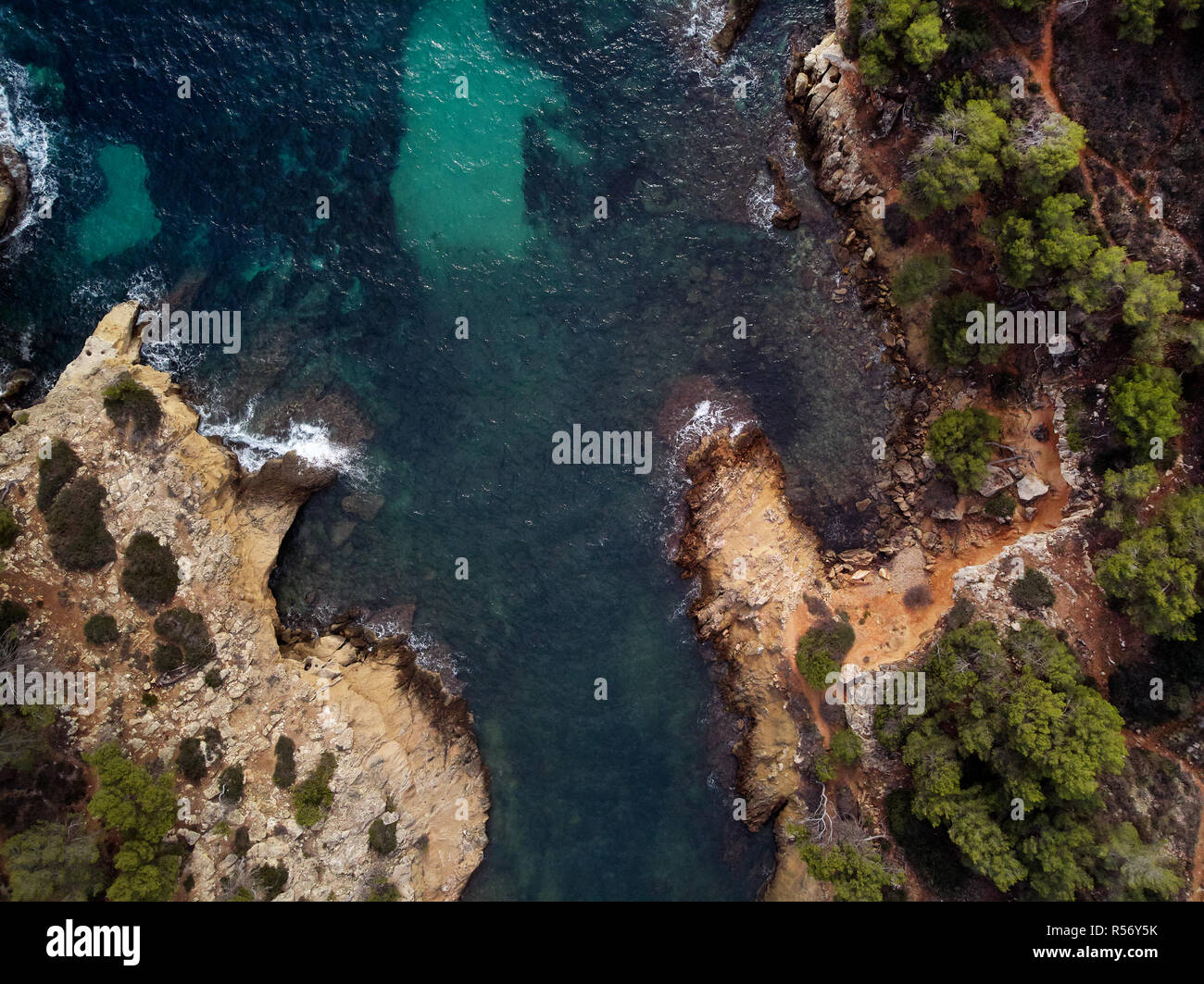 Cap falco beach with turquoise green transparent water and rocky coast, view directly from above. Aerial drone photography. Mallorca or Majorca Island - Stock Image