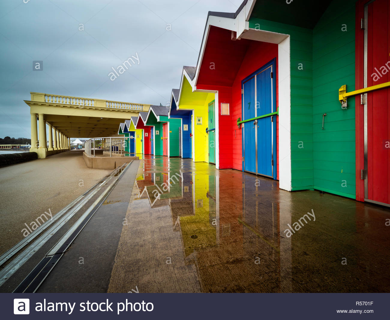 An image of Barry Island beach huts showing how vibrant they are against a dull sky Stock Photo