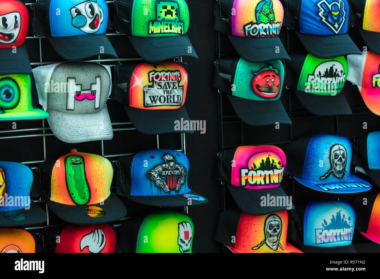d94ecd12d6d Colourful airbrushed caps with a Fortnite design. Fortnite is a popular  video game. -