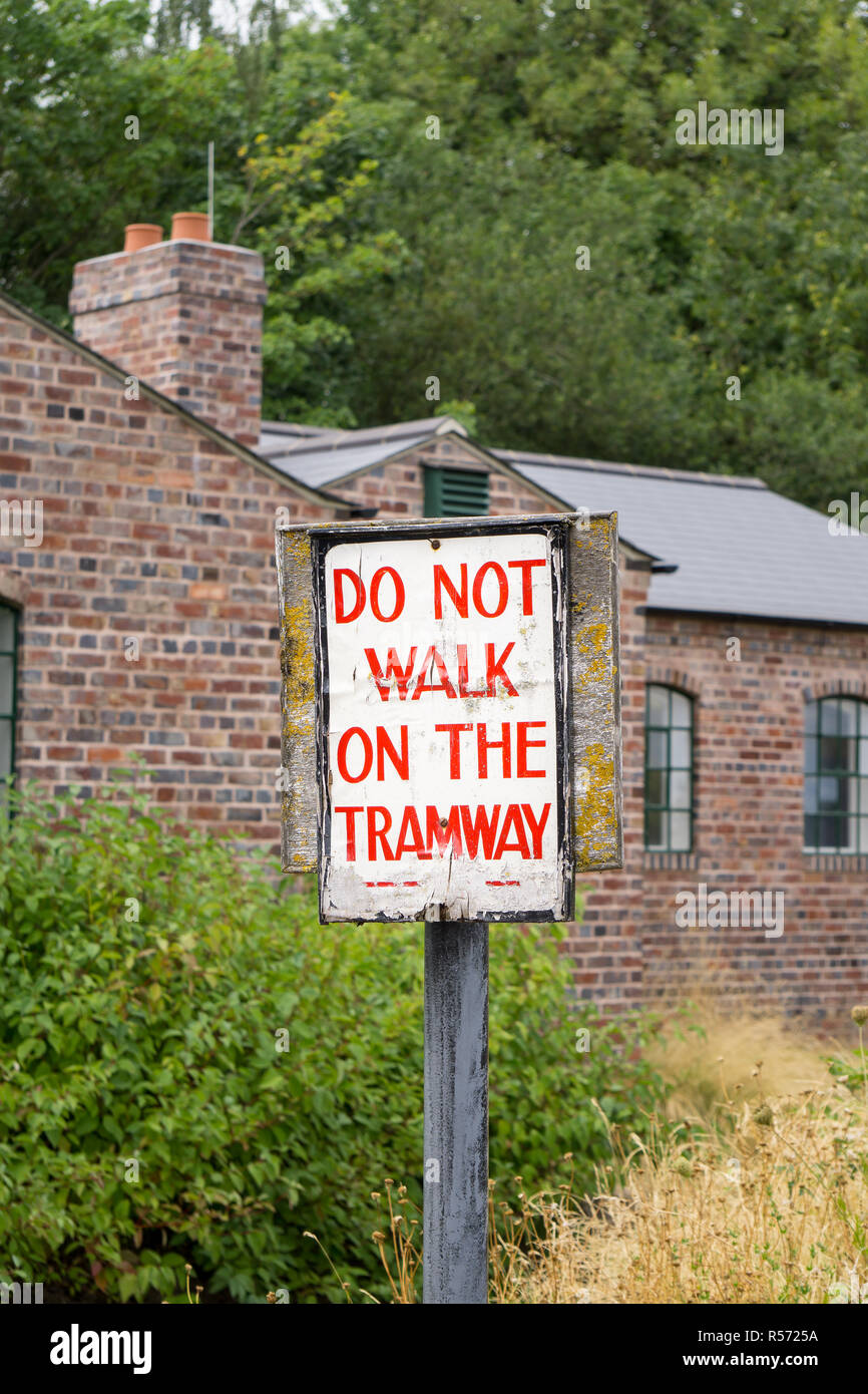 Portrait capture of vintage sign at Black Country Museum on a sunny summer morning warning visitors: Do Not Walk on the Tramway. - Stock Image