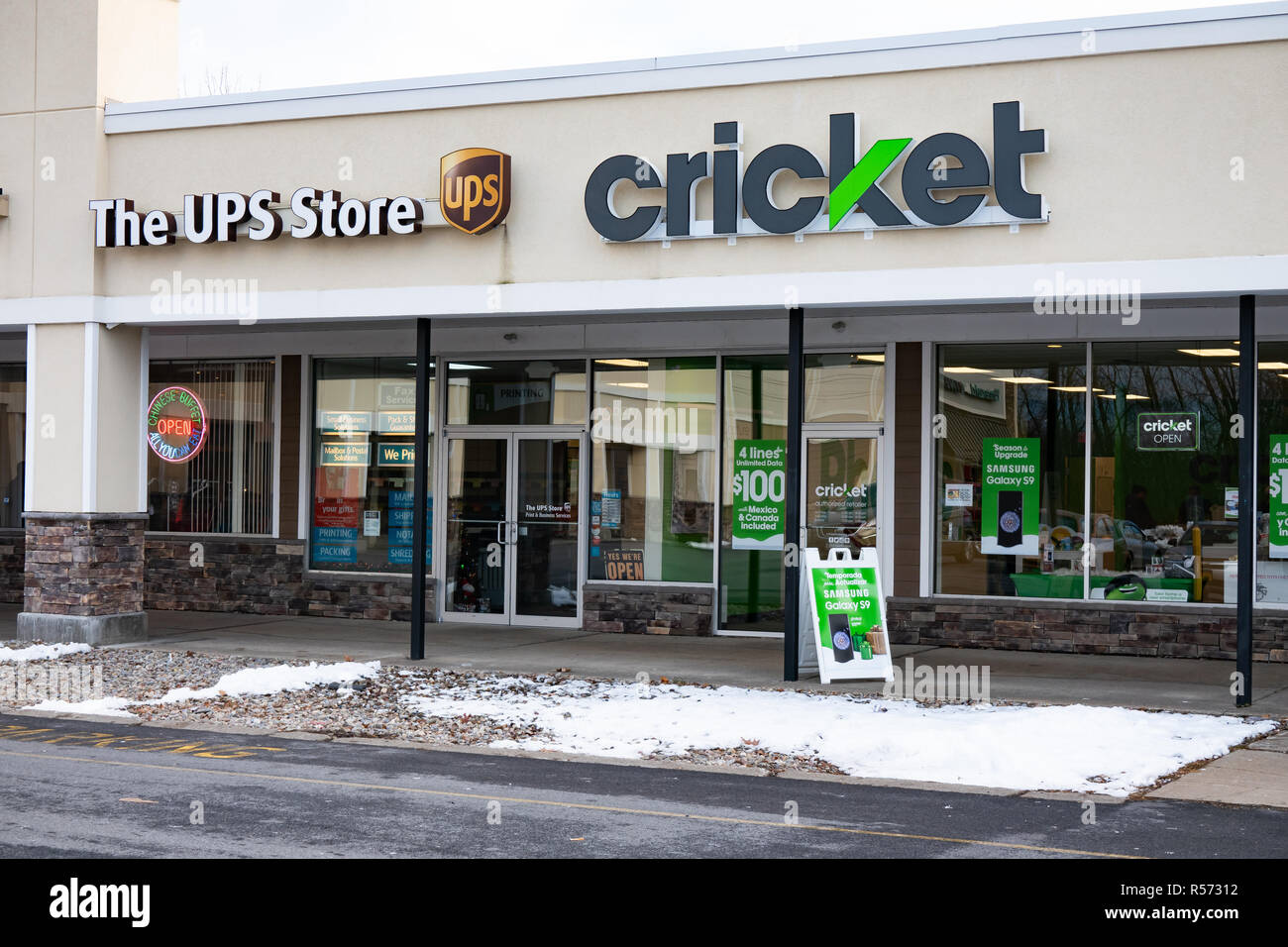 A UPS Store and a cricket wireless phone store in a strip