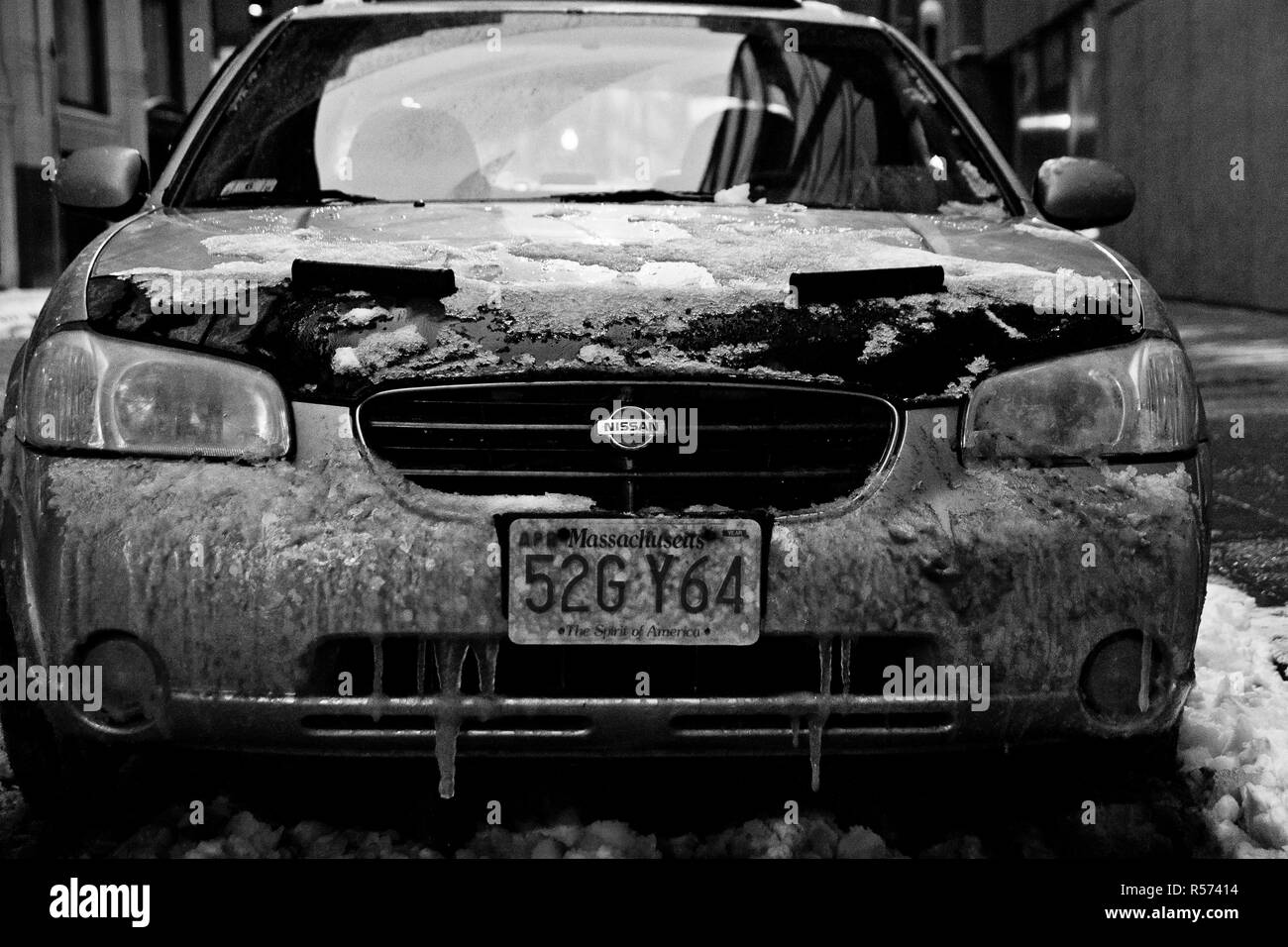 Boston, Massachusett - January 16, 2012: Car with ice and snow parked on the street. - Stock Image