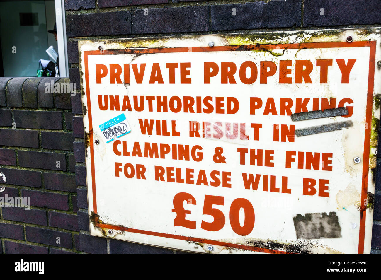 United Kingdom Great Britain England London Westminster sign parking warning private property unauthorized parking fines clamping sterling pounds symb - Stock Image