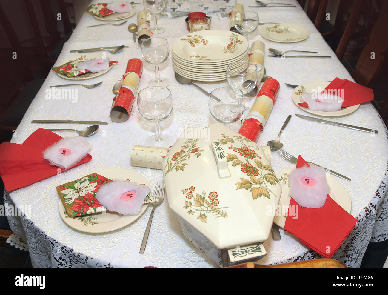 Traditional Christmas decor dinner table setting before meal. - Stock Image