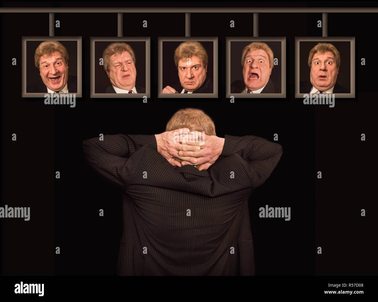 The senior european man in front of posters with his faces. Stock Photo