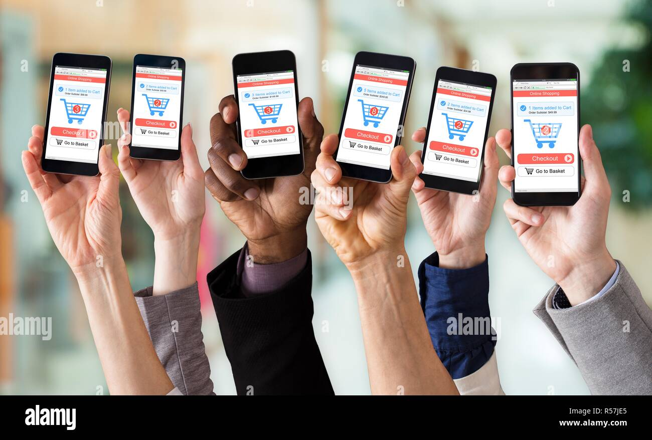Hands Showing Online Shopping Application On Mobile Screen - Stock Image
