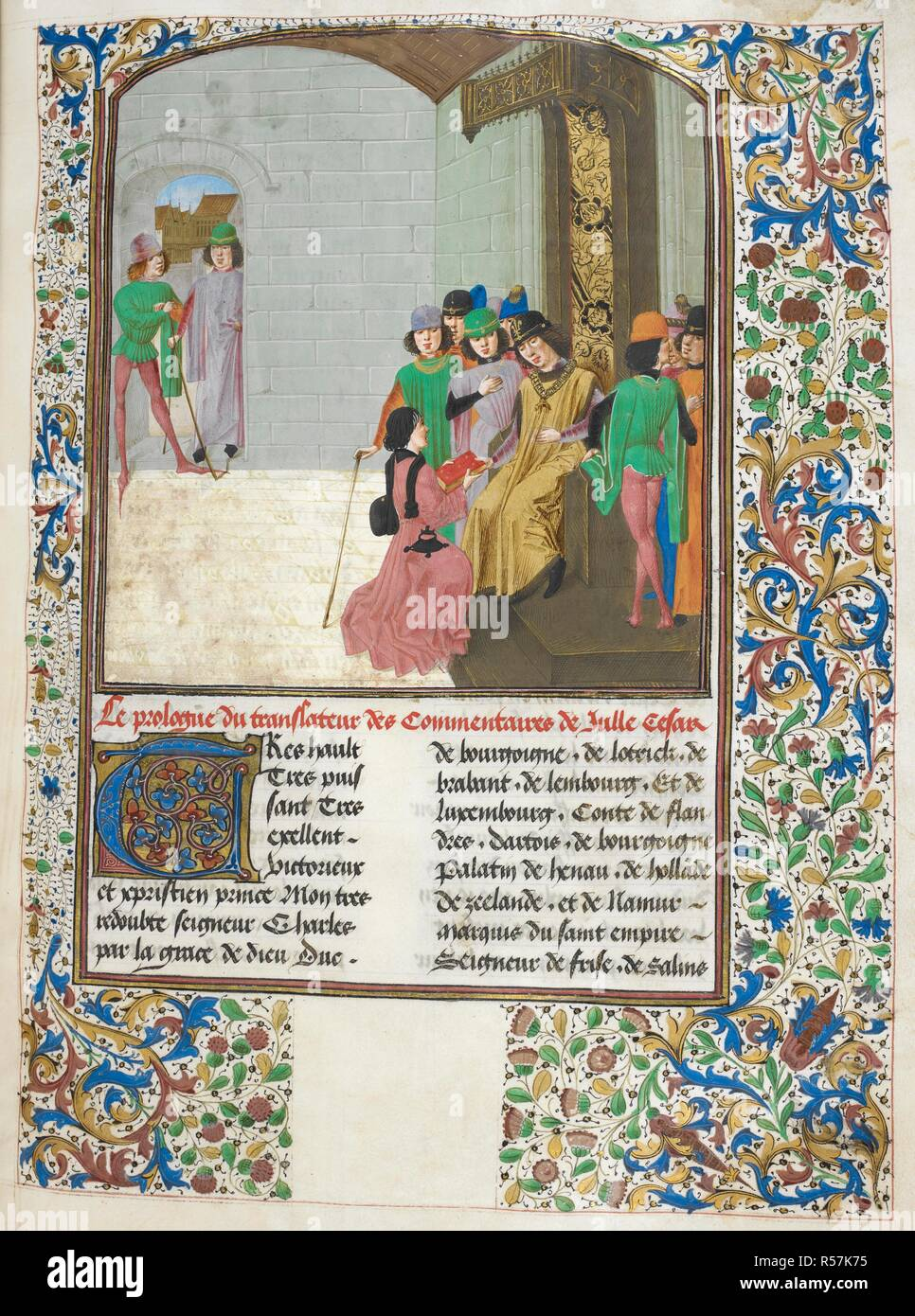 Charles the Bold, Duke of Burgundy, enthroned, dressed in gold and wearing the chain of the Order of the Golden Fleece, receiving a book from the translator of the Commentaries,  Jan Du Quesne, who kneels before him. Caesar, translated by Jan Du Quesne (or Jean Duchesne), Bellum Gallicum ( Les commentaires de Cesar ). 1473-1476. Source: Royal 16 G. VIII, f.14. Language: French. Author: JULIUS CAESAR. Du Quesne, Jehan. - Stock Image