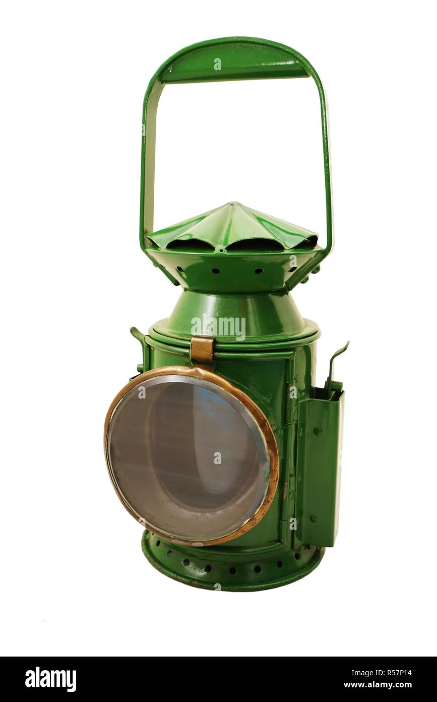 old green signal lamp on white background - Stock Image