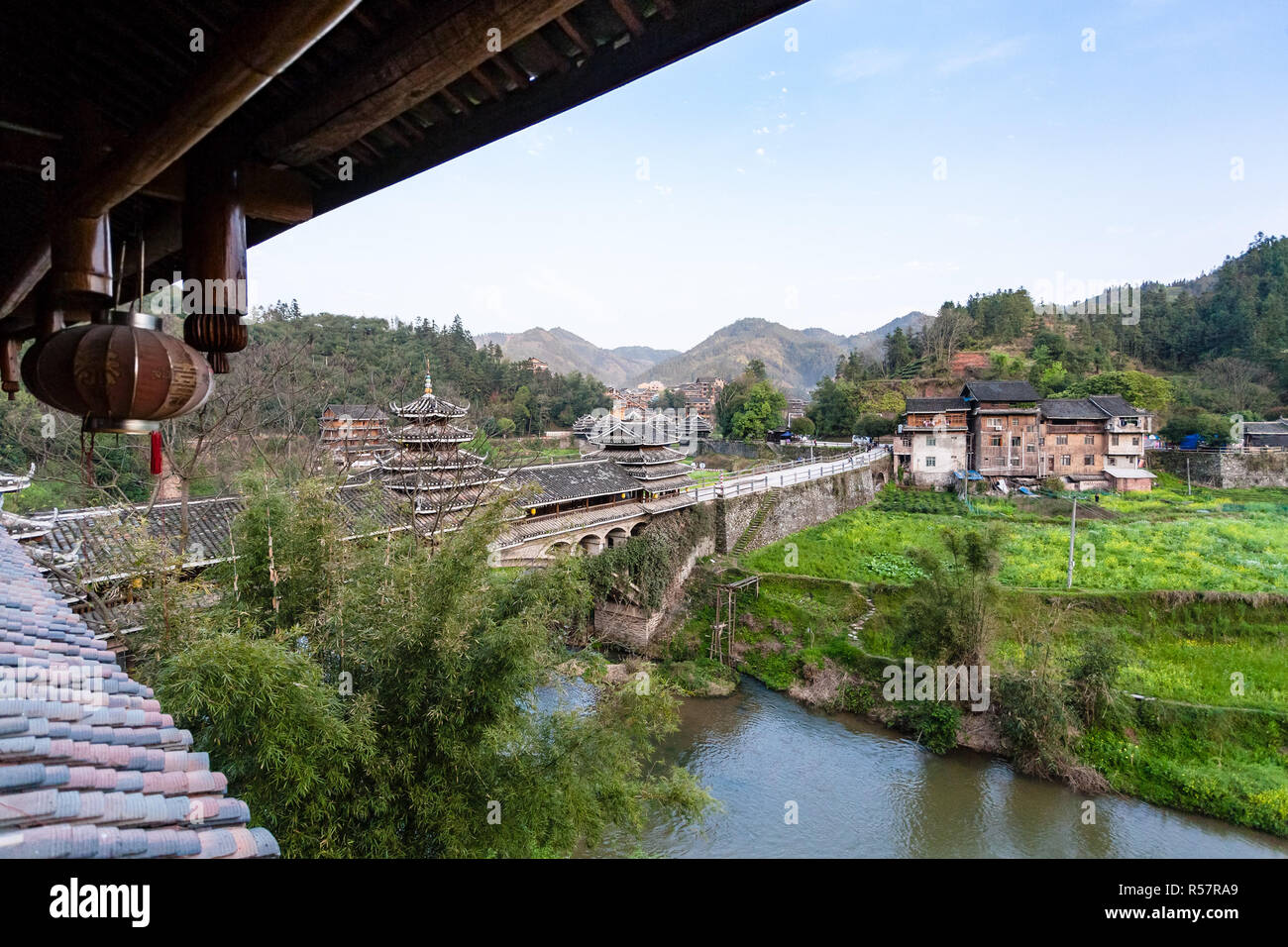 view of Chengyang Wind and Rain Bridge and gardens - Stock Image