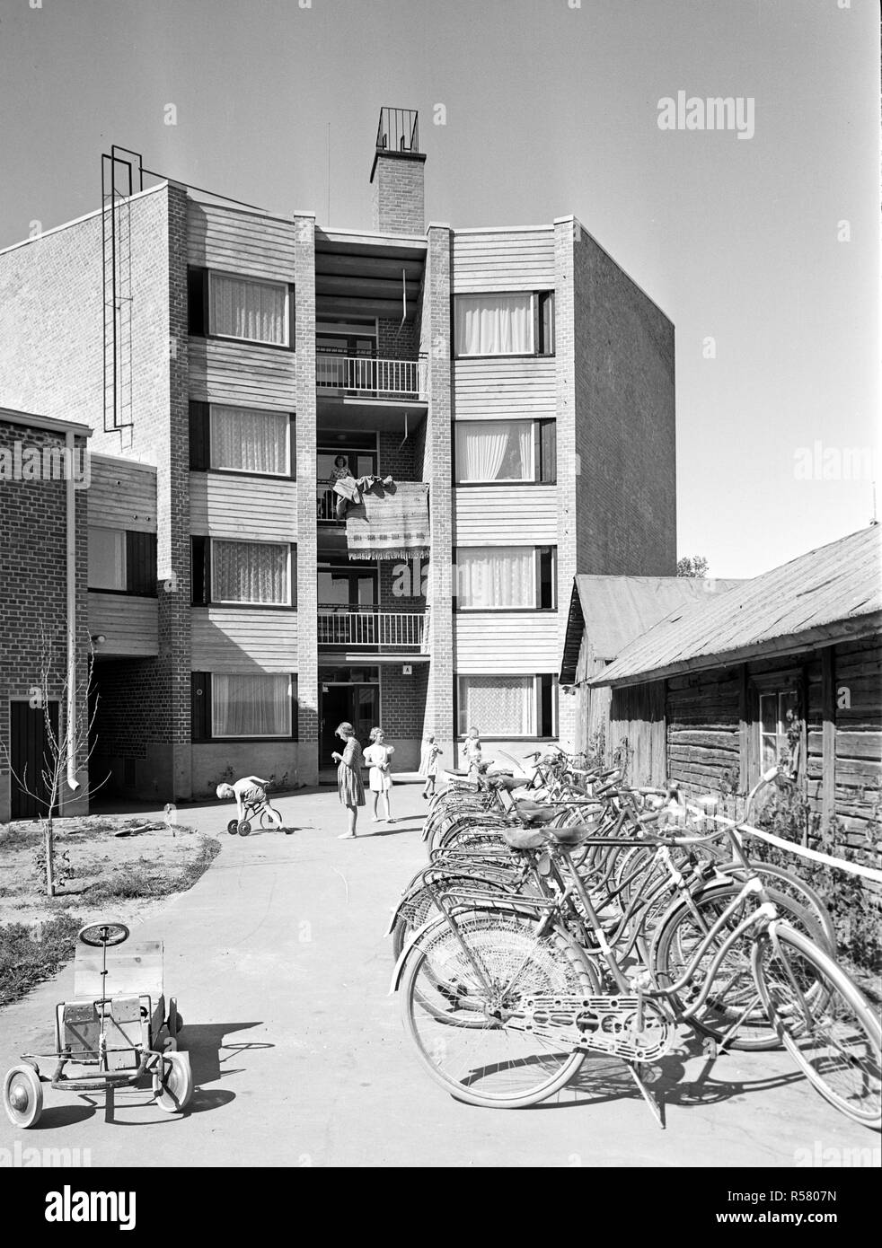 Finland History - Apartment building with bicylcles parked and go-cart, in  Lohja, Uusimaa, Finland in 1955 - Stock Image