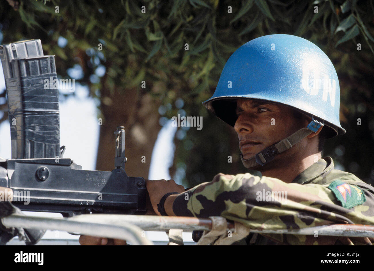 1993 - A member of the Nepalese Quick Reactionary Force (QRF) in Mogadishu Somalia stands ready at his weapon.  The QRF provides foot patrols and guards convoys of United Nations staff members going to their homes. - Stock Image