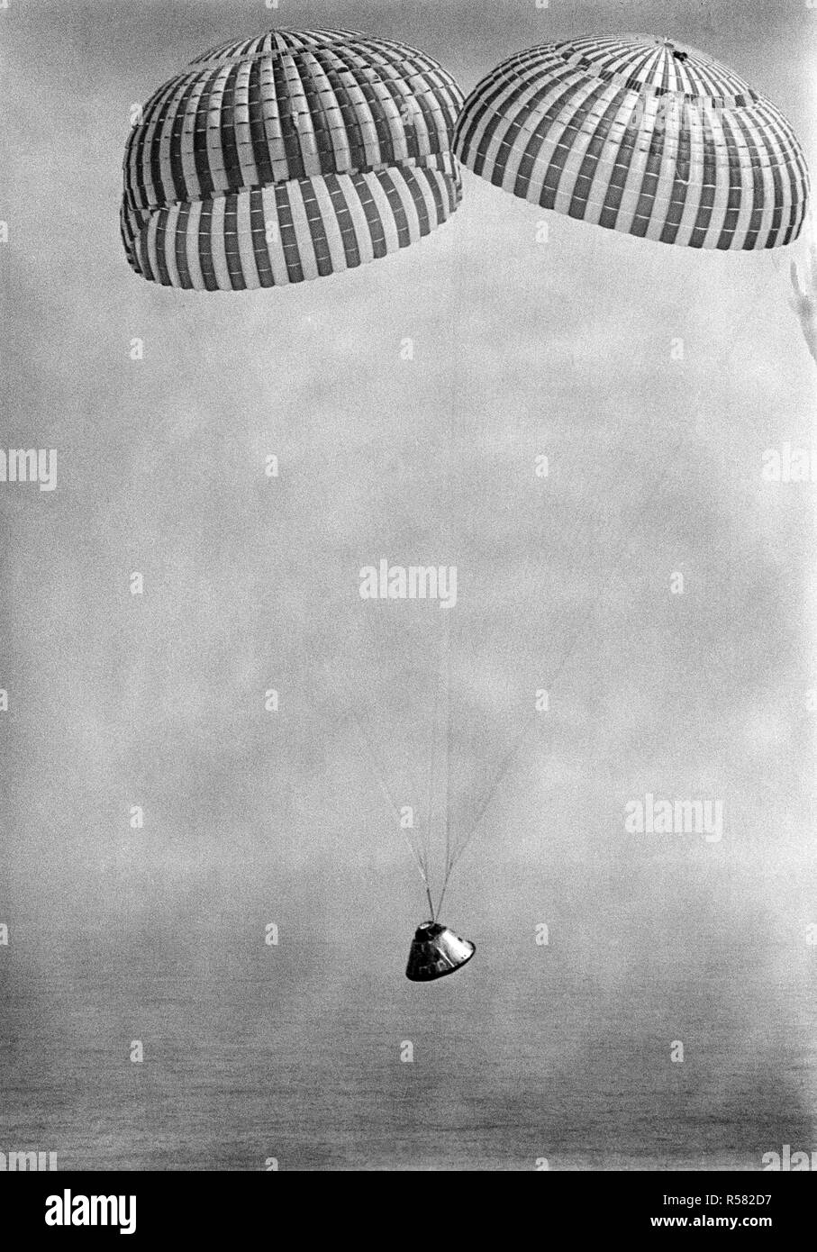 (13 March 1969) --- The Apollo 9 spacecraft, with astronauts James A. McDivitt, David R. Scott, and Russell L. Schweickart aboard, approaches touchdown in the Atlantic recovery area. Splashdown occurred at 12:00:53 p.m. (EST), March 13, 1969, only 4.5 nautical miles from the prime recovery ship, USS Guadalcanal. - Stock Image