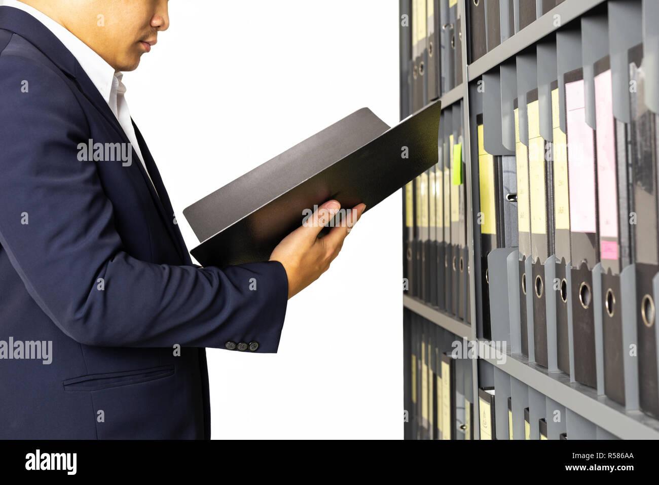 Businessman holding documents file folder from office shelf isolated. - Stock Image