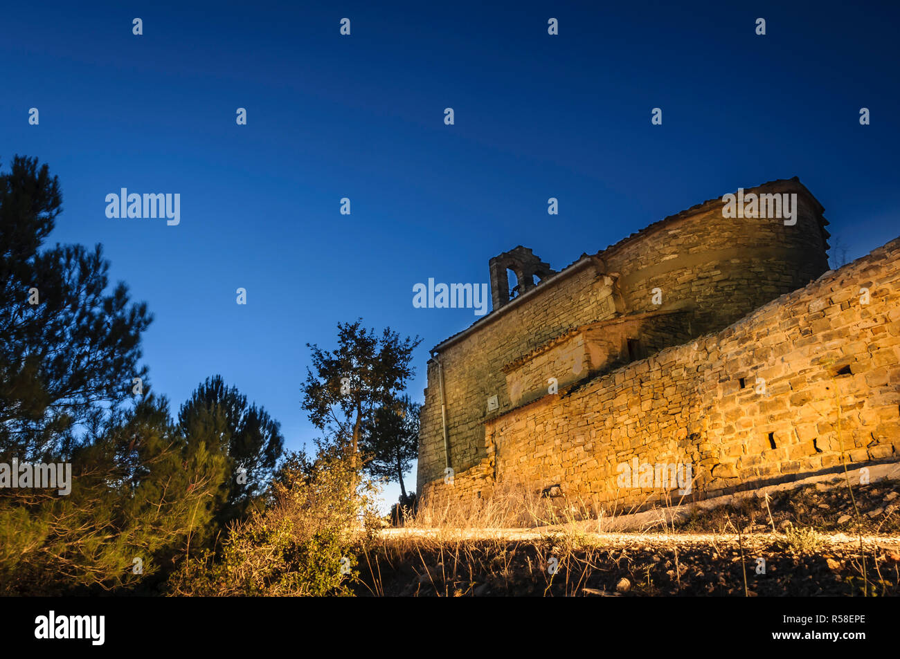 Blue hour at a rural church in Catalonia Spain Veciana - Stock Image
