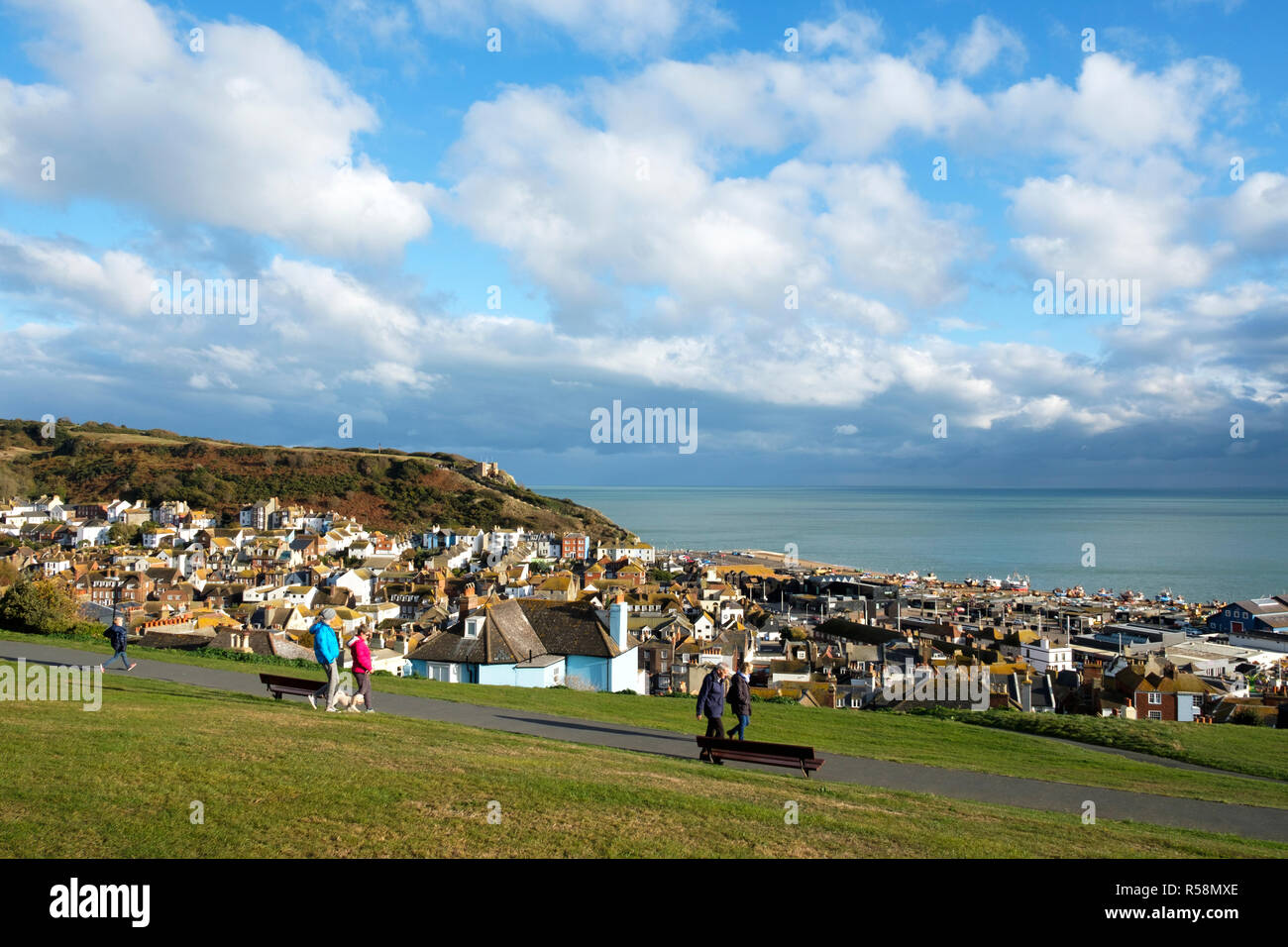 Walkers strolling on West Hill Hastings, in the late October afternoon sunshine at the start of wintertime, East Sussex, UK - Stock Image