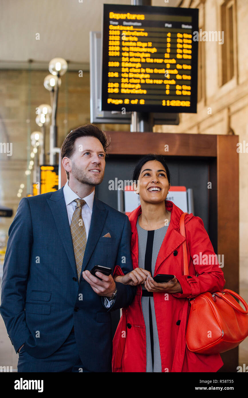 Checking Train Times - Stock Image