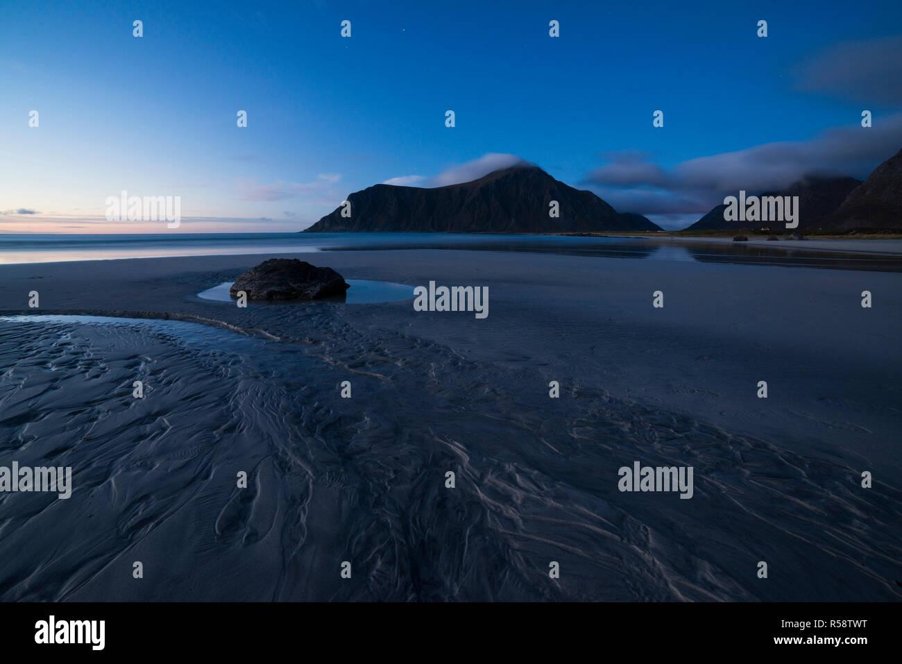 Blue hour over Arctic beach, Skagsanden, Flakstadoy, Lofoten, Norway - Stock Image