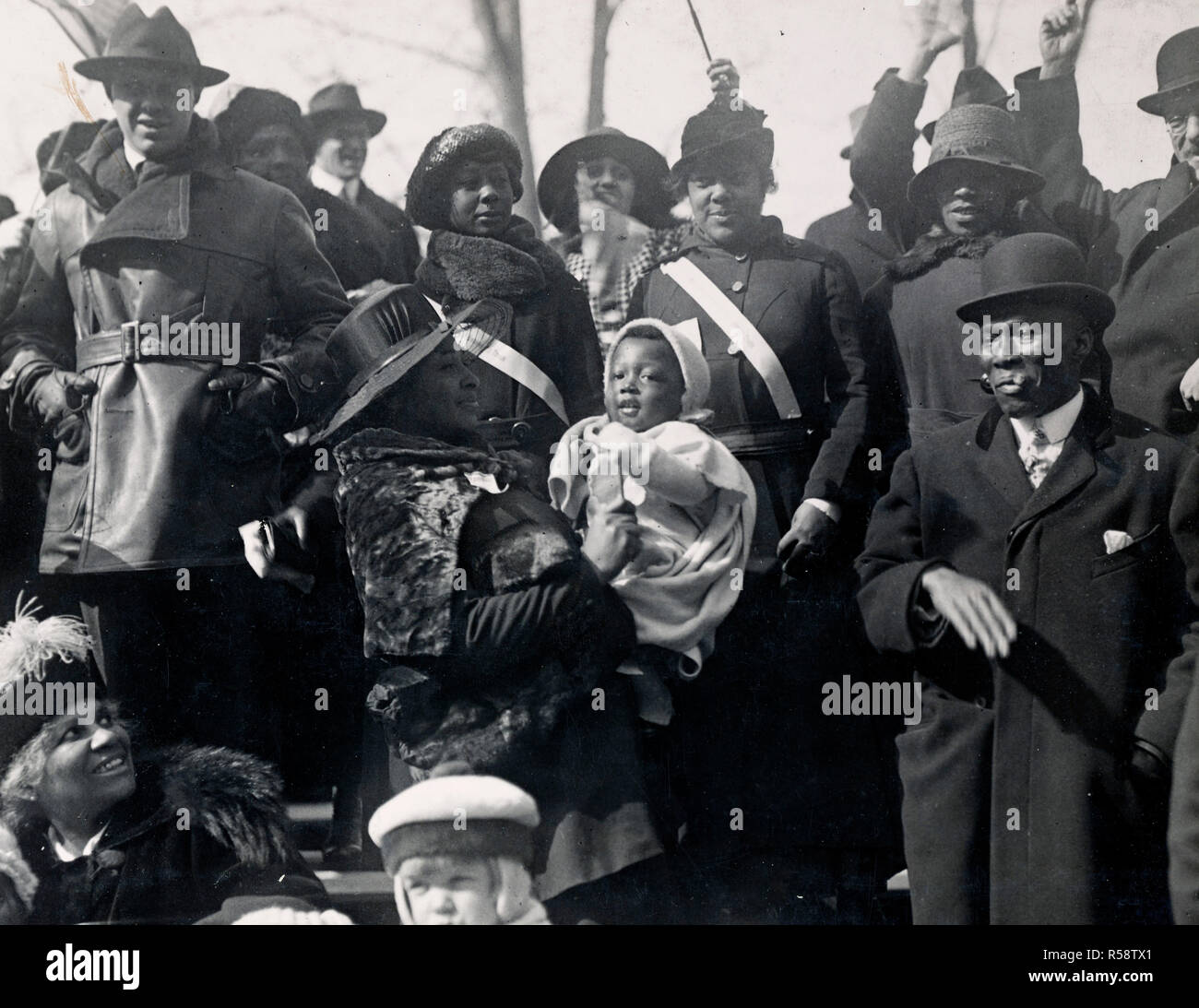 WW I Photos - Colored / African American Troops - Relatives and Friends Cheering the 369the Infantry as the Pass in Parade. New York City's colored population turned out to greet the heroes of the 369th Infantry, the old 15th of New York City, colored fighters who earned all the glories of war in France 2/17/1919 - Stock Image