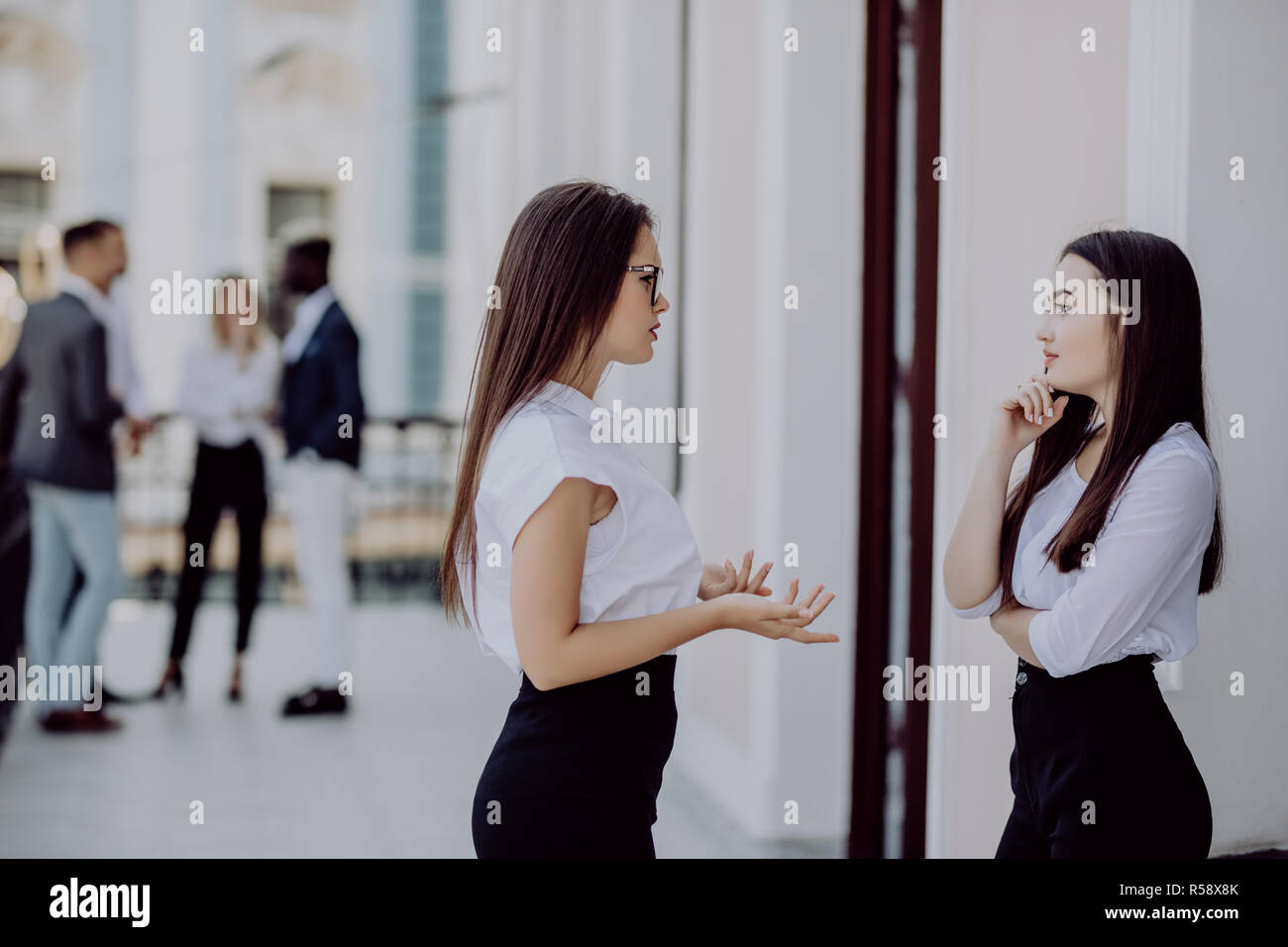 Two bussiness partners man and woman over team background Stock Photo