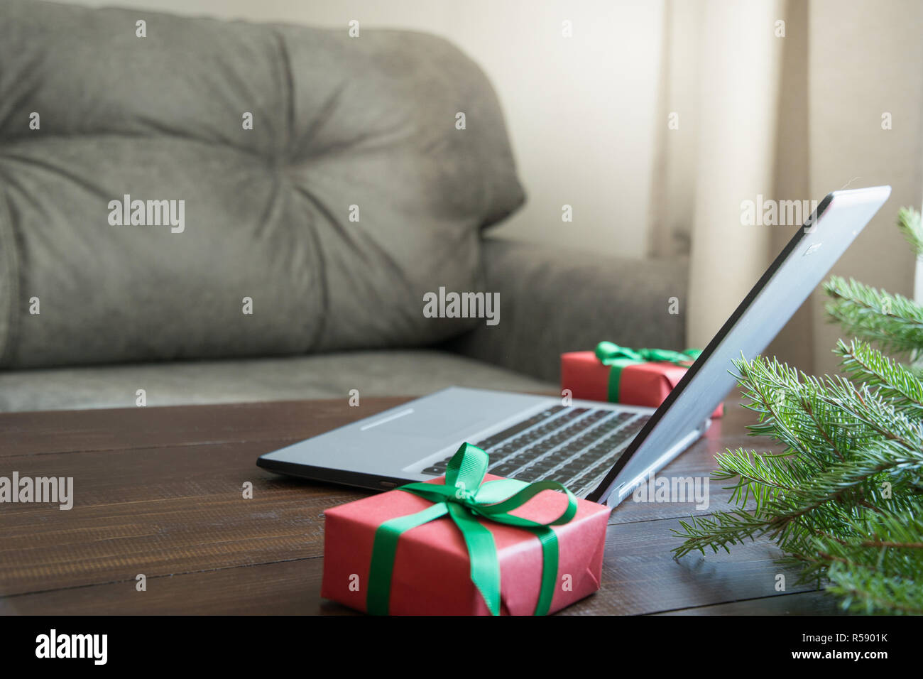Laptop in home interior for booking, planning, search special Christmas offer. Xmas. Planing holidays. - Stock Image