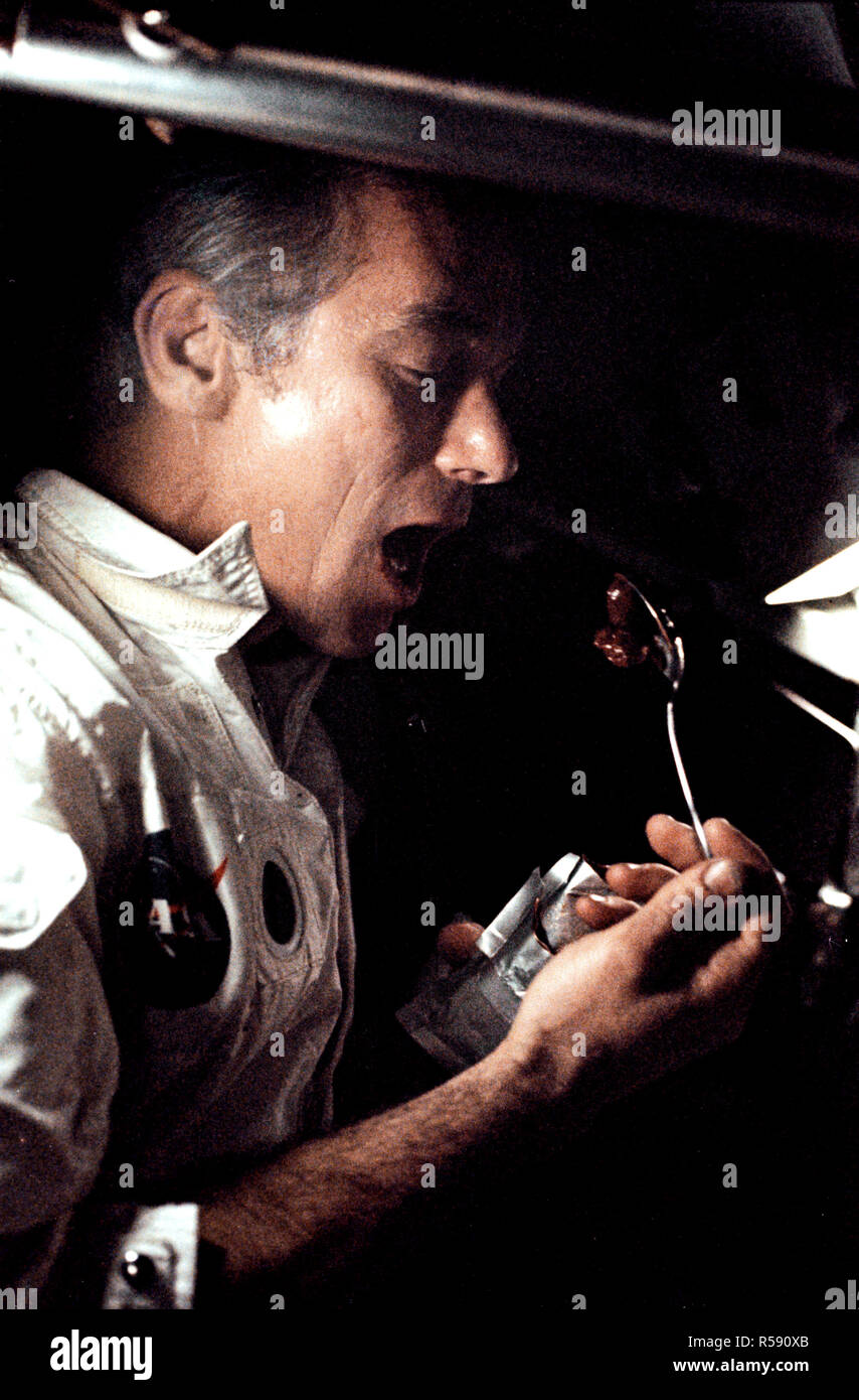 (7-19 Dec. 1972) --- A fellow crewman took this photograph of astronaut Eugene A. Cernan eating a meal under weightlessness conditions of space during the final lunar landing mission in NASA's Apollo program. - Stock Image