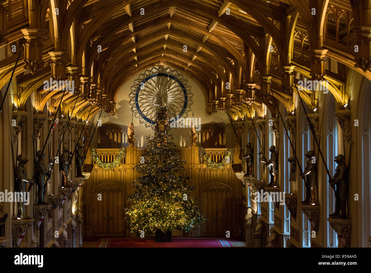 Windsor, UK. 30th Nov, 2018. The State Apartments at Windsor Castle have been decorated with glittering Christmas trees and twinkling lights for Christmas. Seen here in St George's Hall a striking 20ft Nordmann Fir tree from Windsor Great Park dressed in gold. A 15ft Christmas tree also appears in the Crimson Drawing Room. Credit: Mark Kerrison/Alamy Live News - Stock Image