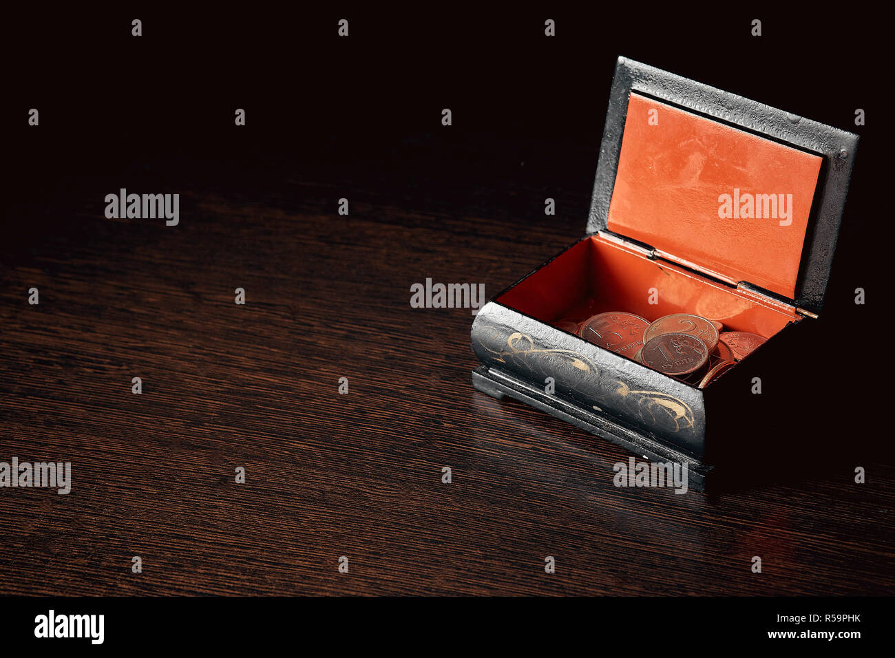 saving money, business concept. Coins on the table near the box - Stock Image