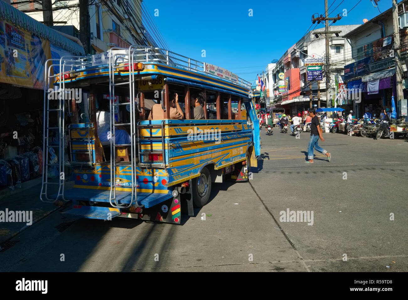 A typical songthaew, a kind of old-time Thai bus, leaving the market in Phuket Town for one of the nearby beaches, Phuket, Thailand - Stock Image