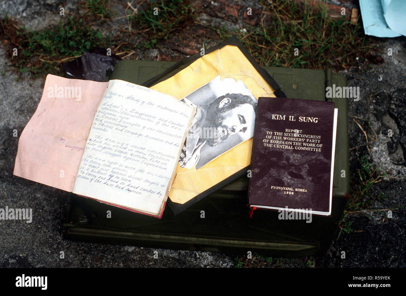 Some communist literature, including a photograph of Cuban President Fidel Castro, seized by US military personnel during Operation URGENT FURY. - Stock Image