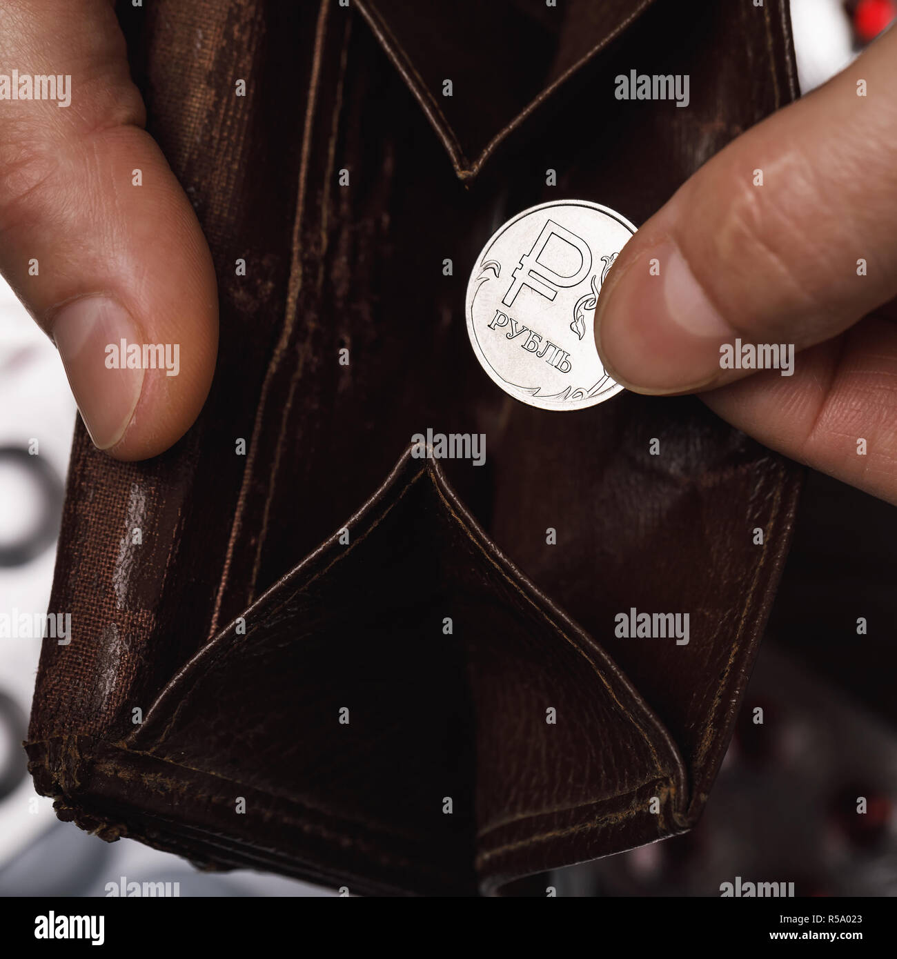 Russian ruble on the background of an open empty wallet. Concept on the lack of money Stock Photo