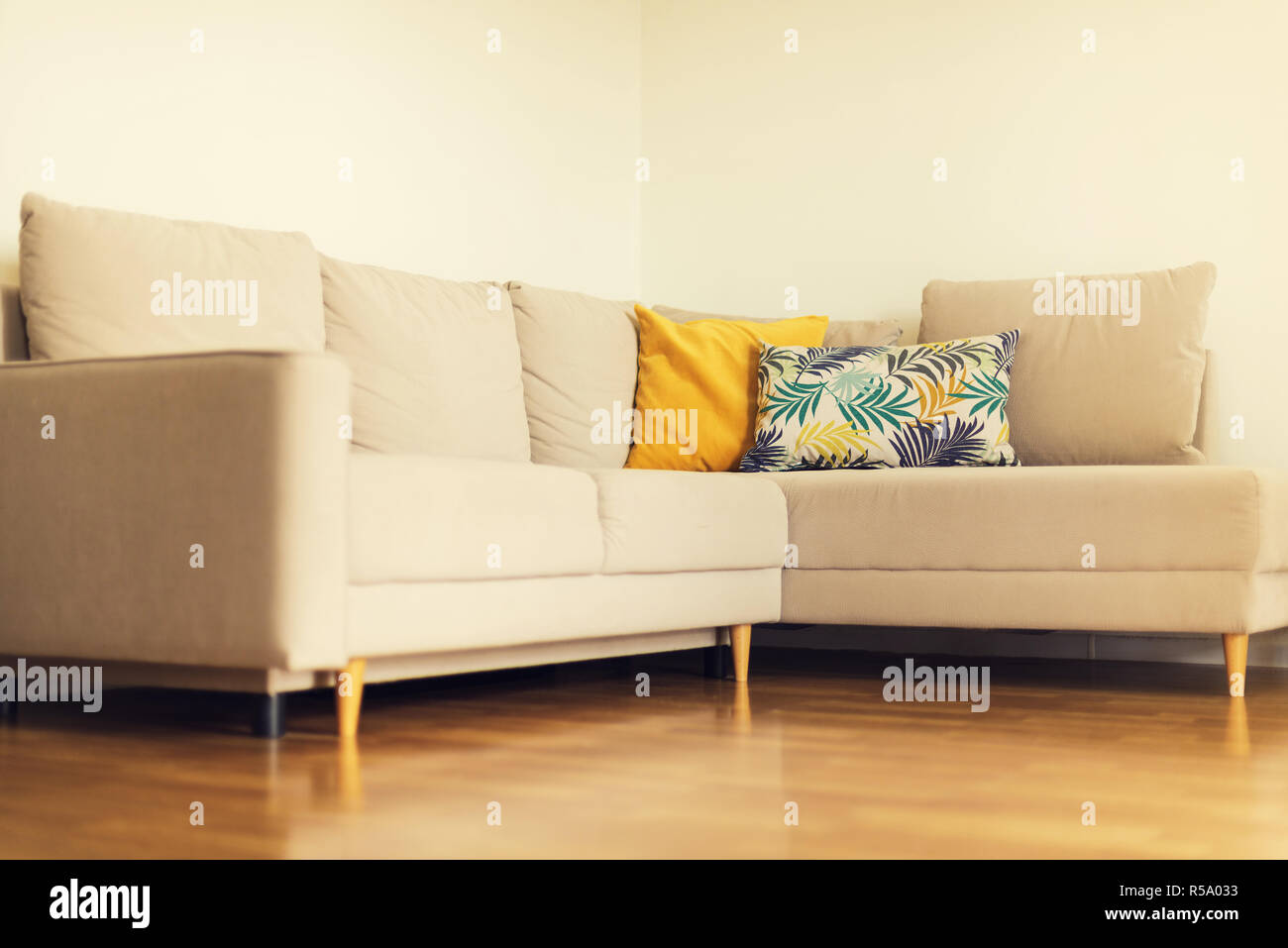 Modern Beige Sofa Yellow And Blue Pillows With Tropical Palms